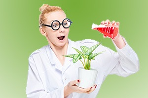 A crazy chemist watering a flower with a chemical substance from